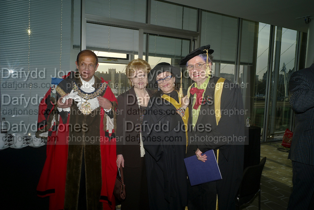 PROCESSION BEFORE GOING IN TO THE CEREMONY; THE MAYOR OF CAMDEN; CARRIE FISHER; DEBBIE REYNOLDS; ,BETTE BOURNE;  Central School of Speech and Drama presents   Fellowships to Carrie Fisher, Bette Bourne, Joseph Selig and Helen Lannaghan. Royal Festival Hall. London. 12 December 2011.