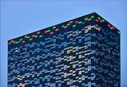 Nederland, Nijmegen, 31-3-2015Het gebouw Fifty-Two-Degrees, 52 degrees, van NXP. In het gebouw,ontworpen door Francine Houben en Francesco Veenstra van Mecanoo architecten, zijn o.a.  kennisbedrijven uit de regio gehuisvest. Ook adviesbureau HaskoningDHV is er gehuisvest. Royal Haskoning DHV, the independent, international, engineering, design and project management consultancy.De bovendste etages van 52Degrees stralen deze week de kleuren van NEC uit vanwege het aanstaande kampioenschap dit weekend.FOTO: FLIP FRANSSEN/ HOLLANDSE HOOGTE