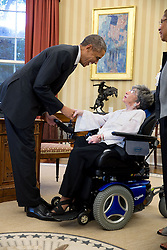 President Barack Obama greets Alyce Dixon, the oldest living African American World War II veteran, in the Oval Office, Oct. 27, 2014. (Official White House Photo by Pete Souza)<br /> <br /> This official White House photograph is being made available only for publication by news organizations and/or for personal use printing by the subject(s) of the photograph. The photograph may not be manipulated in any way and may not be used in commercial or political materials, advertisements, emails, products, promotions that in any way suggests approval or endorsement of the President, the First Family, or the White House.