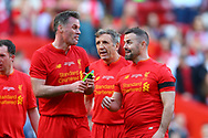 Jamie Carragher of Liverpool legends team (l) and David Thompson of Liverpool legends team (r) have a laugh at the end of the game. Liverpool Legends  v Real Madrid Legends, Charity match for the LFC Foundation at the Anfield stadium in Liverpool, Merseyside on Saturday 25th March 2017.<br /> pic by Chris Stading, Andrew Orchard sports photography.