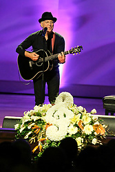 20 November 2015. Orpheum Theater, New Orleans, Louisiana. <br /> Memorial service for musician Allen Toussaint. <br /> Jimmy Buffet performs on stage.<br /> Photo; Charlie Varley/varleypix.com