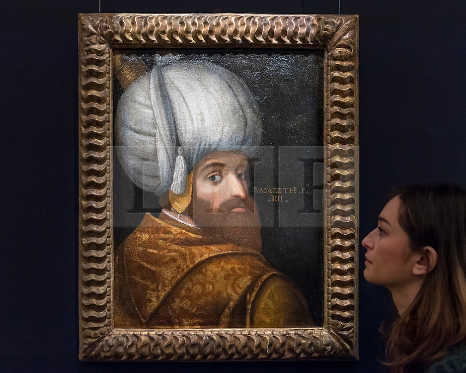 "© Licensed to London News Pictures. 13/10/2016. London, UK. A Sotheby's staff member views ""A portrait of Sultan Bayezid I, School of Veronese, Italy, circa 1580"" (est. GBP 150-200k) at the preview of Sotheby's Art of the Middle East and India exhibition, which presents artworks to be sold in New Bond Street in four sales in October. Photo credit : Stephen Chung/LNP"