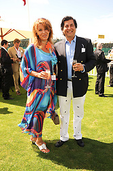 MR & MRS ASHWAN KHANNA at the Cartier International Polo at Guards Polo Club, Windsor Great Park, Berkshire on 25th July 2010.