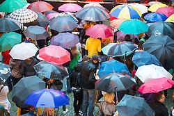THEMENBILD - eine Gruppe Menschen mit vielen bunten Regenschirmen am Samstag den 9. August 2014. Auch in den nächsten Tage soll das Wetter laut Meteorologen regnerisch und kühl bleiben // a group of people with lots of colorful umbrellas on Saturday, August 9, 2014. In the coming days to the weather, according to meteorologists remain rainy and cool. EXPA Pictures © 2014, PhotoCredit: EXPA/ Johann Groder