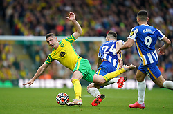 Brighton and Hove Albion's Shane Duffy (centre) and Norwich City's Kenny McLean battle for the ball during the Premier League match at Carrow Road, Norwich. Picture date: Saturday October 16, 2021.