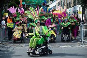 Hackney Carnival on 8th September 2019 in London, United Kingdom. Dancers in wheelchairs as part of the Paracarnival group lead part of the procession.