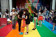 Pride in London, formally known as Pride London, is an annual LGBT pride festival and parade held each summer in London, United Kingdom. A crowd gathers in front of Top Shop window with Loveheart and Happy Pride.