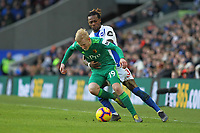 Football - 2018 / 2019 Premier League - Brighton and Hove Albion vs. Watford<br /> <br /> Gaetan Bong of Brighton gets to grips with Will Hughes of Watford during the Premier League match at The Amex Stadium Brighton  <br /> <br /> COLORSPORT/SHAUN BOGGUST