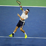 2016 U.S. Open - Day 12  Kei Nishikori of Japan in action against Stan Wawrinka of Switzerland in the Men's Singles Semifinal match on Arthur Ashe Stadium on day twelve of the 2016 US Open Tennis Tournament at the USTA Billie Jean King National Tennis Center on September 9, 2016 in Flushing, Queens, New York City.  (Photo by Tim Clayton/Corbis via Getty Images)