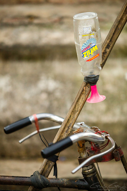 Close up of bicycle handlebars with a homemade horn made from a plastic bottle, Durbar Square, Kathmandu, Nepal