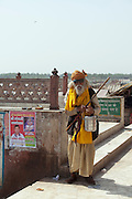 A Sadhu (yogi) holy man at the Embankment of the Ganges River at the holy city of Garhmukteshwar, Uttar Pradesh, India