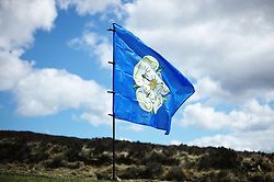 (c) Licensed to London News Pictures. <br /> 28/04/2017<br /> Goathland, UK<br /> <br /> The Yorkshire flag flies over moorland as riders taking part in the Tour de Yorkshire cycling race pass through Goathland on Stage 1 of the three stage race.<br /> <br /> Photo Credit: Ian Forsyth/LNP