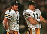 Brett Favre and Matt Hasselbeck during the closing minutes if Mondays game. WSJ/Apps.
