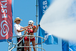 Eskimo girl cools off fans with water from fireman pipe at A1 Beach Volleyball Grand Slam tournament of Swatch FIVB World Tour 2010, semifinal, on August 1, 2010 in Klagenfurt, Austria. (Photo by Matic Klansek Velej / Sportida)