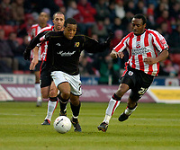 Photo: Alan Crowhurst.<br />Southampton v Milton Keynes Dons. The FA Cup.<br />07/01/2006. <br />Wade Small (L) attacks for Dons.