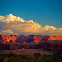 Sunset glow and shadows in a big sky southwest-scape in Monument Valley