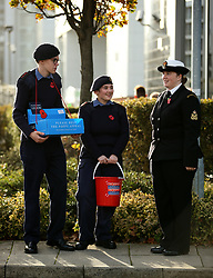 Members of the Royal Air Force Air Cadets and Navy Sea Cadets collecting for the Poppy Appeal before the game