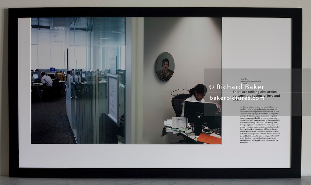 A casually-dressed accountant works in a cluttered office cubicle in an auditing company's London headquarters.<br /> <br /> A limited edition (2 of 6) Lambda digital framed print created for the Werk Nu (Work Now) exhibition at the Z33 Gallery in Hasselt, Belgium and including specially selected text by Alain de Botton from his 'The Pleasures and Sorrows of Work' book (Hamish Hamilton, 2009). <br /> <br /> The photograph is the copyright Richard Baker. The text is the copyright Alain de Botton.<br /> <br /> For print sales enquiries email: richard(at)bakerpictures.com