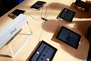 Shadows of customers cast on a table displaying iPads during the opening of Apple Inc's new store in Shanghai, China, on Friday, Sept. 23, 2011. Apple Inc. is currently has 5 stores in mainland China as it struggles to open enough stores to stave off competition of its popular iPhones and iPads