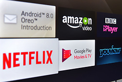 Stock photo of TV programme viewing apps, including, amazon video, BBC iPlayer, Netflix, Google Play and youview, available on a smart television.