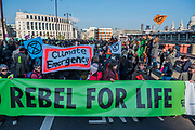 Blackfriars Bridge is blocked - Extinction Rebellion Day -  co hosted by Rising Up, 'Rebel Against the British Government For Criminal Inaction in the Face of Climate Change Catastrophe and Ecological Collapse'. A protest that involves blocking 5 bridges: Southwark, Blackfriars, Waterloo, Westminster and Lambeth.