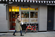 Street Scene of a Chopper bicycle outside a cafe in Soho, London, England, United Kingdom.