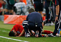 Photo: Glyn Thomas.<br />Sweden v England. FIFA World Cup 2006. 20/06/2006.<br /> England's Michael Owen (L) with an injured leg.