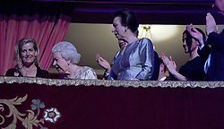 Queen Elizabeth II, surrounded by members of the royal family, takes her seat at the Royal Albert Hall in London to attend a star-studded concert to celebrate her 92nd birthday.