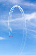 The Snowbirds in a Big Diamond formation complete a loop with smoke.  The Snowbirds are also known as the 431 Air Demonstration Squadron and fly the Canadair CT-114 Tutor jet. Photographed during the Canada 150 celebrations in White Rock, British Columbia, Canada.