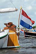 Koningin Beatrix bij vlootschouw jubileum KWVL, Loosdrecht. /// Queen Beatrix Jubilee naval review KWVL<br /> <br /> Op de foto / On the photo:  Koningin Beatrix aan boord van De Groene Draeck op de Loosdrechtse Plassen