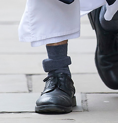 © Licensed to London News Pictures. 24/03/2016. London, UK. An ankle tag on the leg of Radical preacher ANJEM CHOUDARY as he arrives at The Old Bailey. Choudary is alleged to have invited support for the Islamic State group in individual lectures which were subsequently posted online. Photo credit: Peter Macdiarmid/LNP