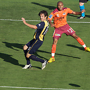 Andrtew Clark (left) and Henrique in action during the Central Coast Mariners V Brisbane Roar A-League match at Bluetongue Stadium, Gosford, Australia, 19 December 2009. Photo Tim Clayton