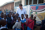 Mcc0039986 . Daily Telegraph..DT Weekend..Magnus MacFarlane-Barrow ceo of Mary's Meals with children at the Telegraph sponsored Chirimba Primary School in Blantyre, Malawi where his Charity feeds 6000 children from the ages of 6-16 every school day..Mary's meals feeds over 500,000 children in Malawi and over 600,000 children worldwide. Malawi is one of the poorest countries in the world and the concept behind Mary's Meals is to provide a daily meal in a place of education, attracting chronically poor children to the classroom where they can gain a basic education that could one day provide an escape route out of poverty. ..Malawi 20 May 2012.