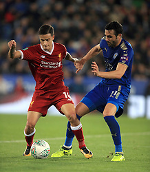 """Liverpool's Philippe Coutinho (left) and Leicester City's Vicente Iborra during the Carabao Cup, third round match at the King Power Stadium, Leicester. PRESS ASSOCIATION Photo. Picture date: Tuesday September 19, 2017. See PA story SOCCER Leicester. Photo credit should read: Mike Egerton/PA Wire. RESTRICTIONS: EDITORIAL USE ONLY No use with unauthorised audio, video, data, fixture lists, club/league logos or """"live"""" services. Online in-match use limited to 75 images, no video emulation. No use in betting, games or single club/league/player publications."""