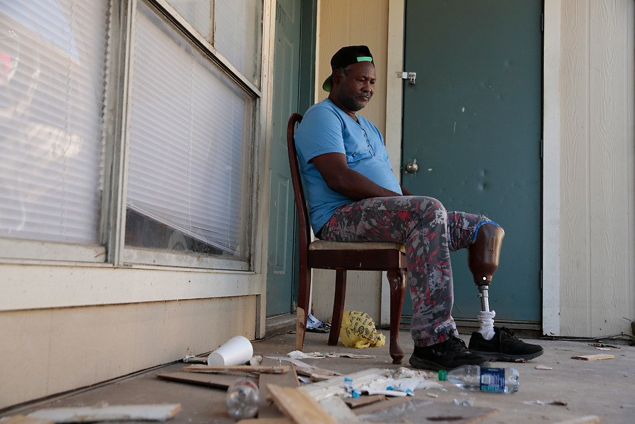 """Isom Horace, 61, sits on the from porch of his north Houston apartment in the aftermath of Hurricane Harvey in Houston, Texas, U.S. September 8, 2017. Although he still has to pay rent, Horace doesn't know where he will stay the night. He can't stay in his apartment because it is so badly damaged and lined with mold and mildew. """"It was like a river was running through the apartment...home sweet home,"""" he said."""