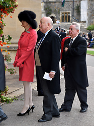 Julian Fellowes and Emma Joy Kitchener arrive for the wedding of Princess Eugenie to Jack Brooksbank at St George's Chapel in Windsor Castle.
