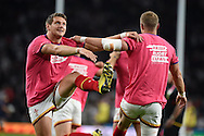 Wales players Rhys Priestland and Dan Biggar (l)warm up pre-match. . Rugby World Cup 2015 pool A match, England v Wales at Twickenham Stadium in London, England  on Saturday 26th September 2015.<br /> pic by  Andrew Orchard, Andrew Orchard sports photography.