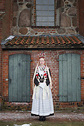 Jasmin, member of the Trachten- und Volkstanzkreis Luhmühlen, is wearing a traditional costume in Salzhausen, Lower Saxony, Germany on March 4, 2018.<br /> <br /> Groom: Gerrit<br /> <br /> The traditional costume and the bridal crown are replicas of the original costumes.