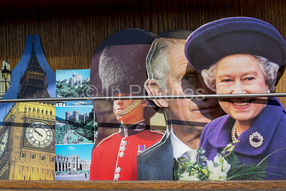 A day after British Prime Minister Boris Johnson successfully asked the Queen to suspend prorogue Parliament in order to manoeuvre his Brexit deal with the EU in Brussels, Queen Elizabeth and her son, Prince Charles are being sold as postcards alongside scenes of Windsor Castle, a Grenadier Garudsman and the clockface of Big Ben at the top of Elizabeth Tower, at a tourist kiosk, on 29th August 2019, in Westminster, London, England.