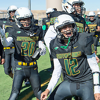 Skyhawks defensive back Haundrus Yazzie (12), celebrates on the sideline after he intercepted the pass against the Mavericks on Saturday in Newcomb. Newcomb defeated Lordsburg 56-20.