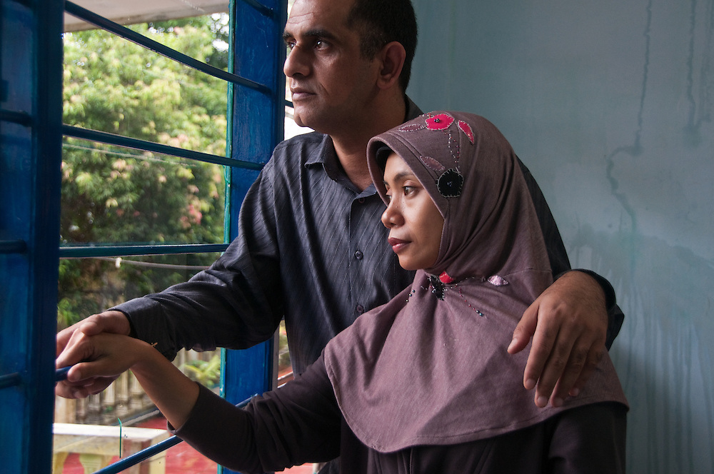 Indonesia, Java. Iraqi refugee and his Indonesian wife awaut relocation in Australia after seven years as a refugee.