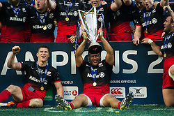 Mako Vunipola of Saracens with the European Rugby Champions Cup trophy - Mandatory byline: Patrick Khachfe/JMP - 07966 386802 - 14/05/2016 - RUGBY UNION - Grand Stade de Lyon - Lyon, France - Saracens v Racing 92 - European Rugby Champions Cup Final.