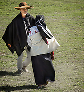 A couple dancing at a Kapak Raymi ceremony in Cotacach, Ecuador
