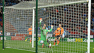 Jacob Butterfield (centre) of Huddersfield Town scores against Brighton and Hove Albion during the Sky Bet Championship match at the John Smiths Stadium, Huddersfield<br /> Picture by Graham Crowther/Focus Images Ltd +44 7763 140036<br /> 21/10/2014