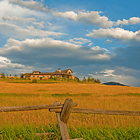 Dramatic clouds soar over Montana's Gallatin Valley and residence of Robert and Sally Uhlmann.