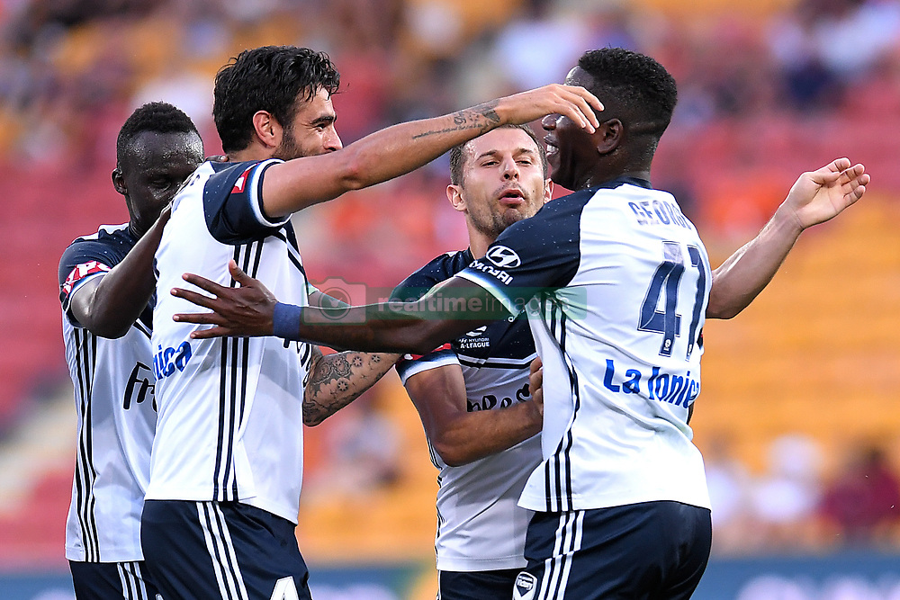 December 17, 2017 - Brisbane, QUEENSLAND, AUSTRALIA - Rhys Wiliams of Melbourne Victory (4, left) celebrates with team mates after scoring a goal during the round eleven Hyundai A-League match between the Brisbane Roar and the Melbourne Victory at Suncorp Stadium on Sunday, December 17, 2017 in Brisbane, Australia. (Credit Image: © Albert Perez via ZUMA Wire)