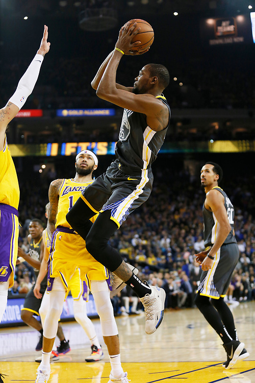 Golden State Warriors forward Kevin Durant (35) attempts a field goal against the Los Angeles Lakers in the first half of an NBA game at Oracle Arena on Saturday, Feb. 2, 2019, in Oakland, Calif.
