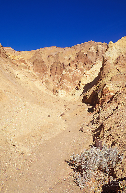 Morning light on eroded hills and ravine in Golden Canyon, Death Valley National Park, California