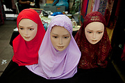 Head scarves for sale at a stall selling clothes for Muslims on Whitechapel Market in the East End of London. The Muslim population in this area is by a huge amount the most predominant, with Bangladeshi's making up some 55% of the local people. The head scarf is on almost every other person.