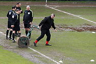 referee Darren England and his officials inspect the Rodney Parade pitch after a downpour of heavy rain an hour and half before k/o. EFL Skybet football league two match, Newport county v Crawley Town at Rodney Parade in Newport, South Wales on Saturday 1st April 2017.<br /> pic by Andrew Orchard, Andrew Orchard sports photography.